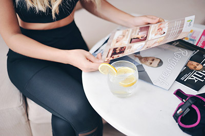 woman relaxing with drink and magazines - Photo by ŞULE MAKAROĞLU on Unsplash