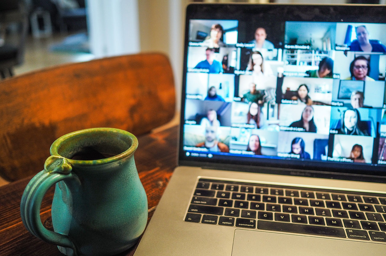 Photo of a video call on a laptop with a mug next to it - Photo by Chris Montgomery on Unsplash
